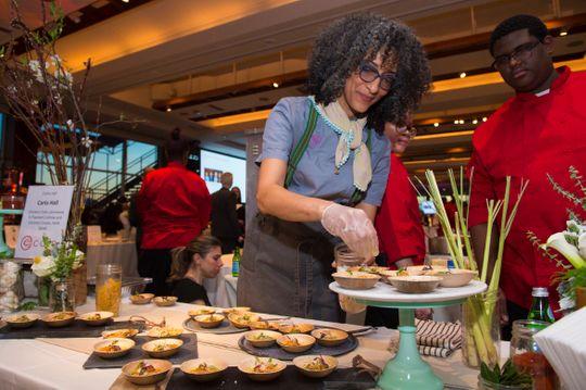 Chef Carla Hall plating food