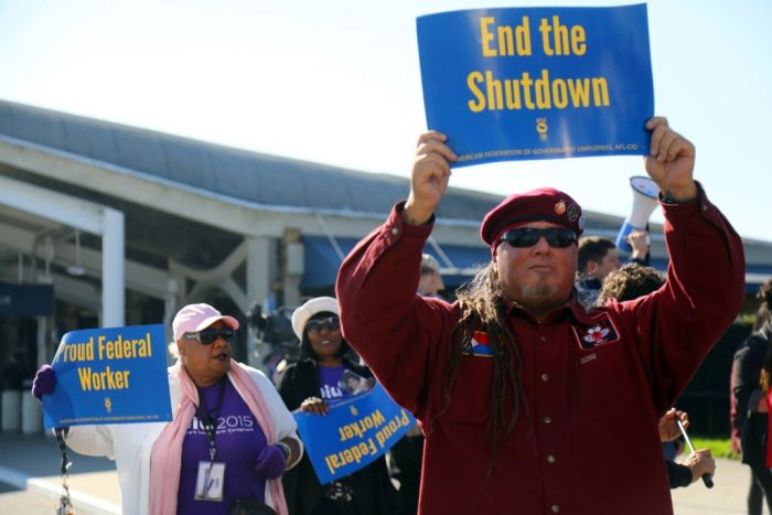 Protesters holding End the Shutdown signs