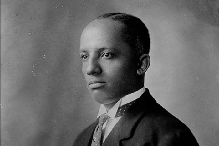 Black and white portrait of Carter G Woodson