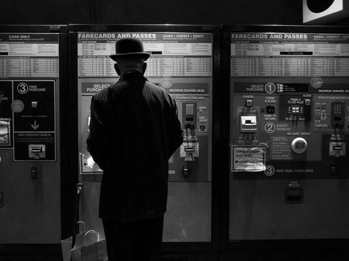 Man in hat buying Metro ticket