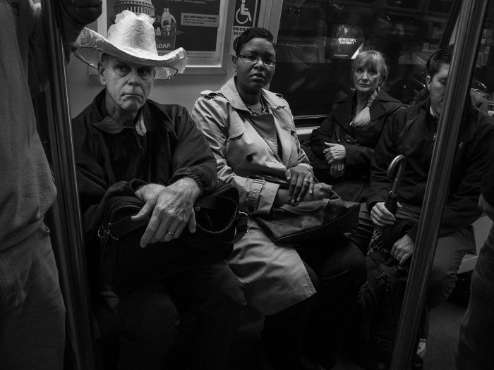 Man in cowboy hat sitting next to African American woman