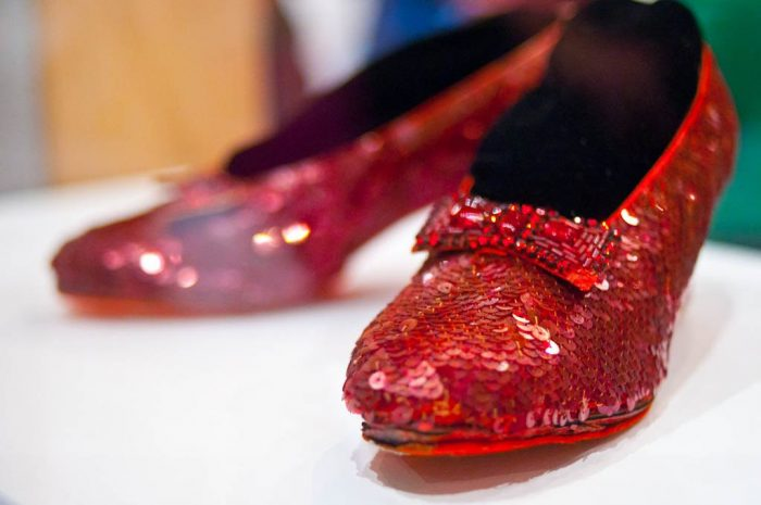 Close up of ruby slippers in display cabinet