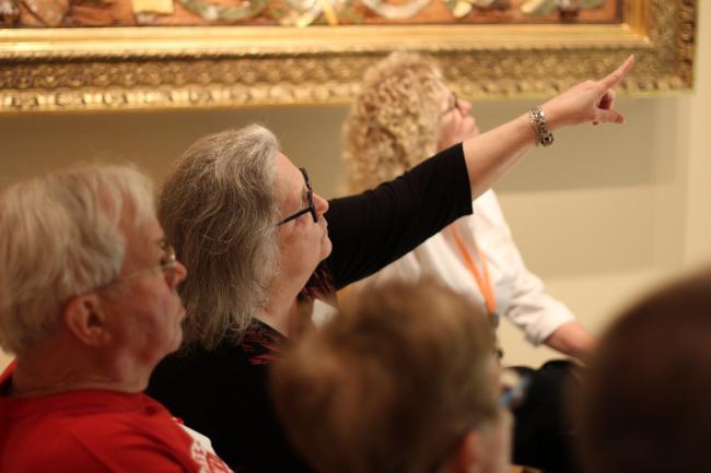 Volunteers in audience, one raising hand