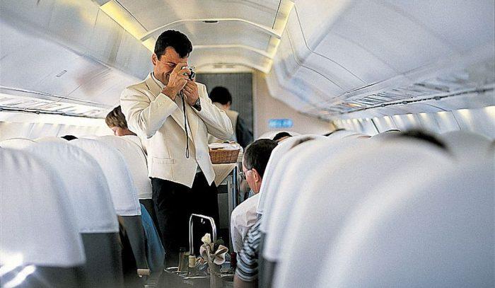 Steward taking photo of passenger