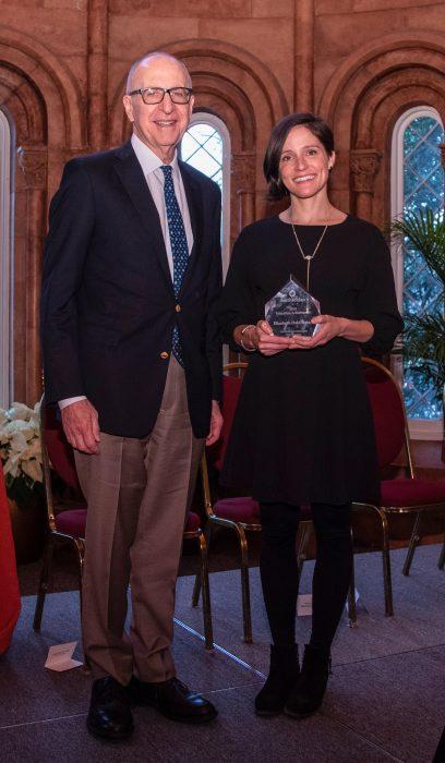 Elizabeth holds award standing next to Secretary