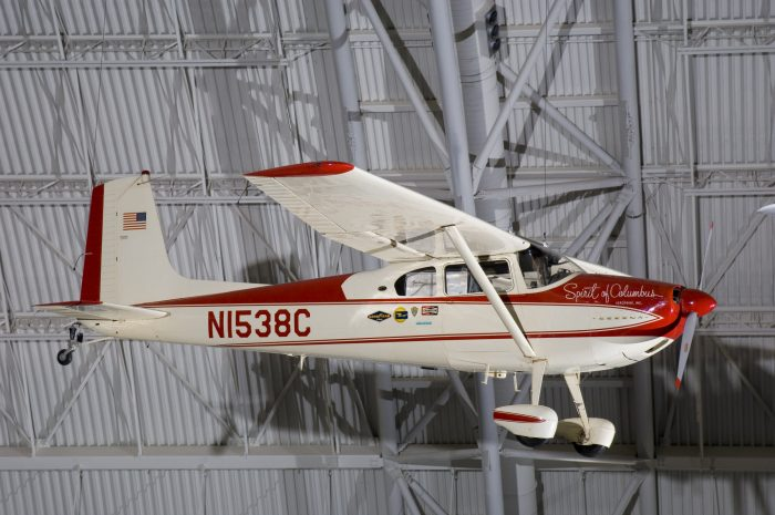 Plane suspended from hangar ceiling