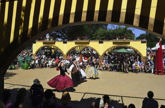 Costumed dancers in pavillion