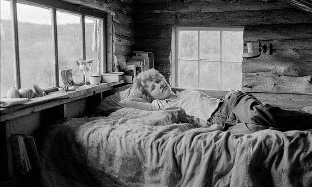 Black and white photo of woman on bed
