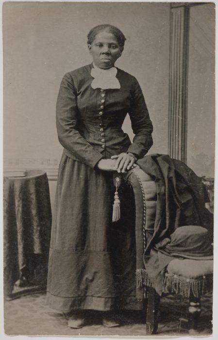 Tubman standing in dark suit