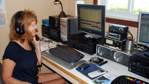 Woman operating ham radio station