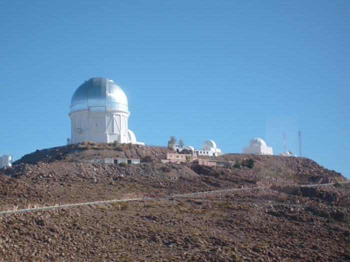Observatory outlined against blue sky