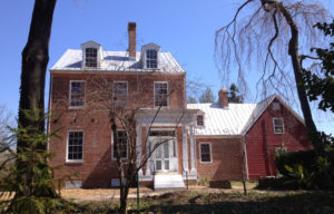 Old brick house and attached outbuilding