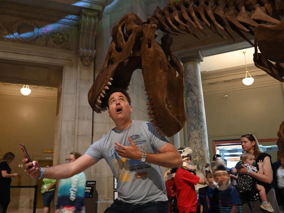 Visitor fakes fear at dinosaur