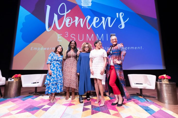 Five women on stage at Women's Summit