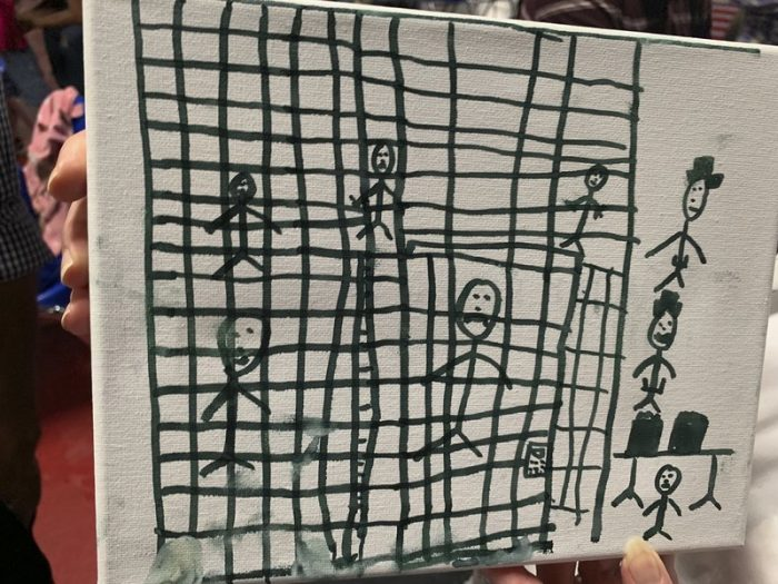 Drawing of people in cages made by migrant child