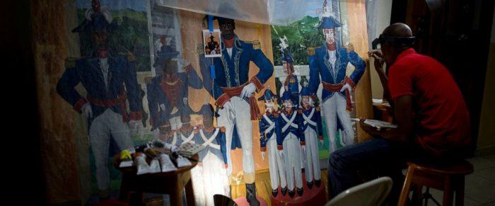 Haitian artist works on painting
