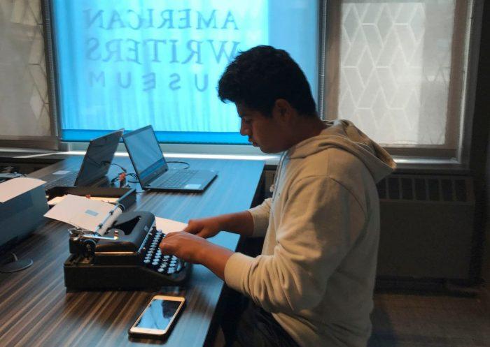 Man using a manual typewriter