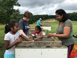 Young volunteers sifting for artifacts