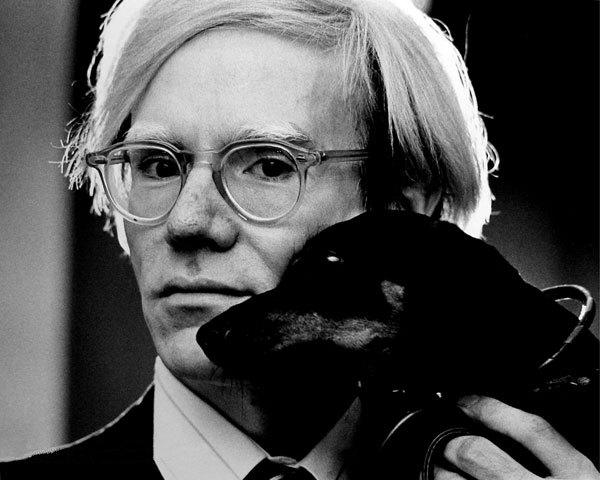 Warhol holding a dachsund