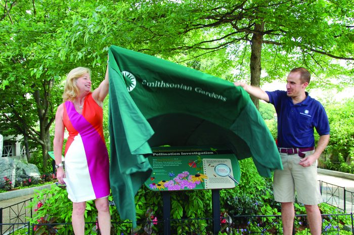 Faust and colleague unveil exhibit sign
