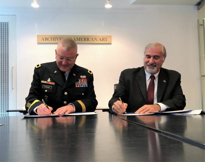 Richard Kurin and Gen Coggin sign agreement