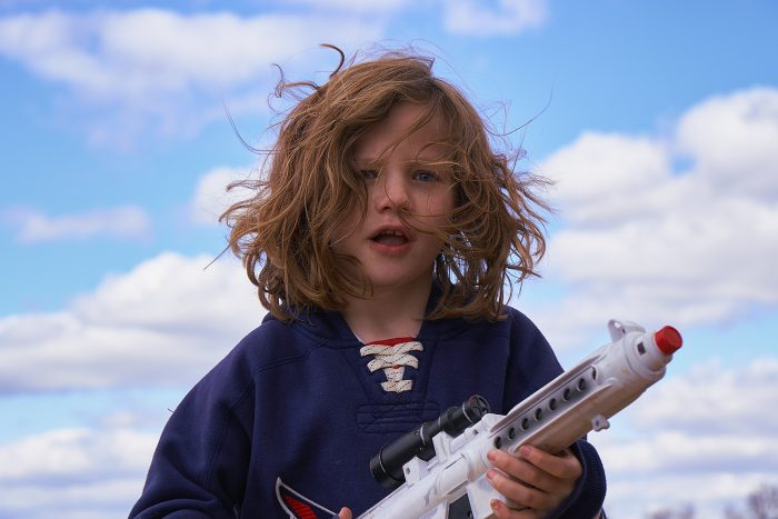 Child holding nerf gun