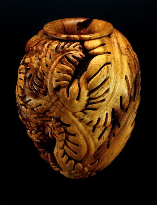 Elaborately carved wooden vase