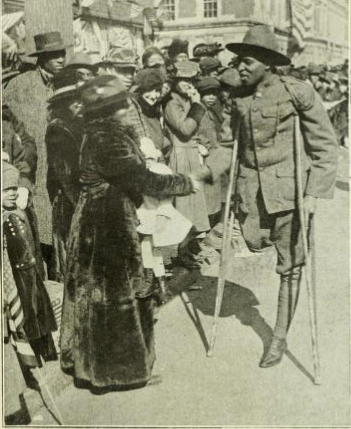 WWI soldier with one leg greeting wellwishers