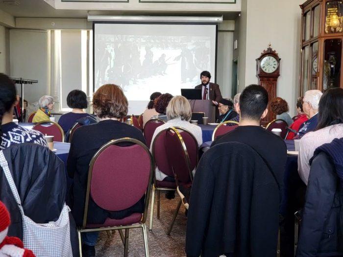 Volunteers listen to presentation