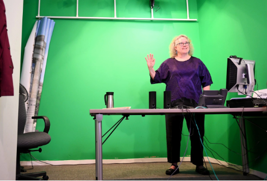 Instructor in front of green screen