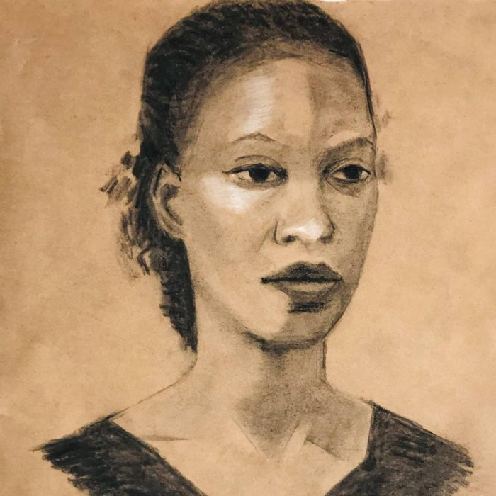 Charcoal portrait of young woman