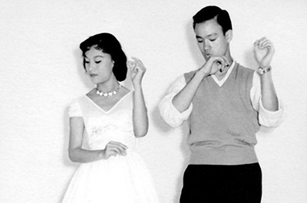 Bruce Lee doing the cha cha with unidentified partner