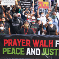 Protesters carrying Prayer Walk banner