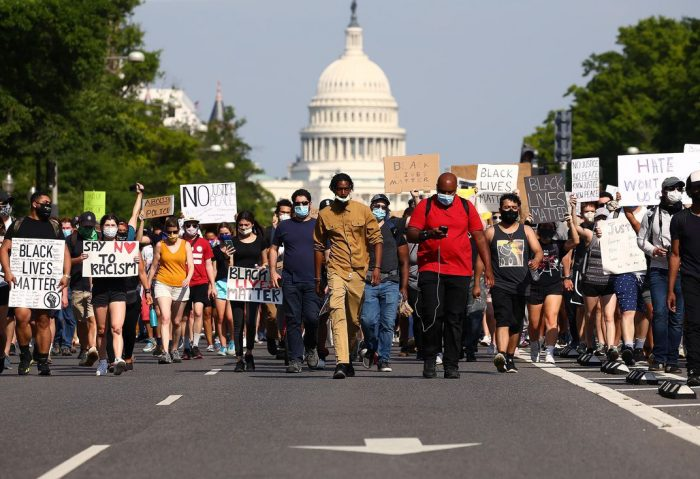 BLM protesters marching with Capitol building in the background