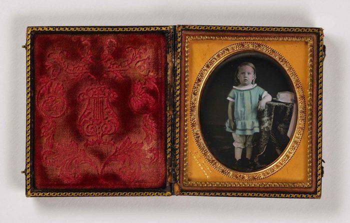 portrait of child in red velvet case