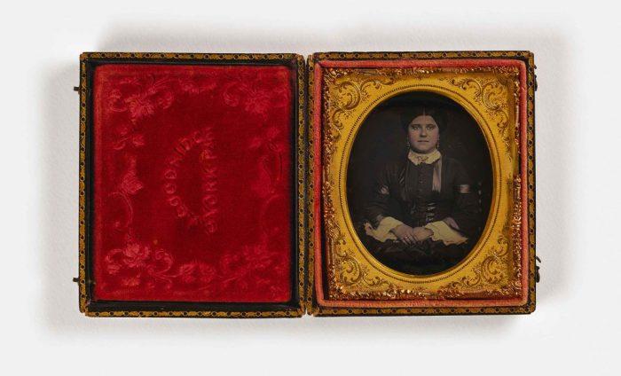 Portrait of woman in red velvet case
