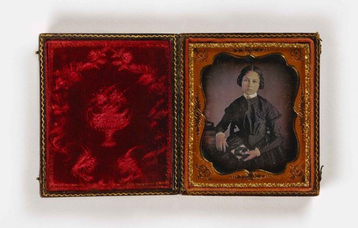 Portrait of young woman in red velvet case