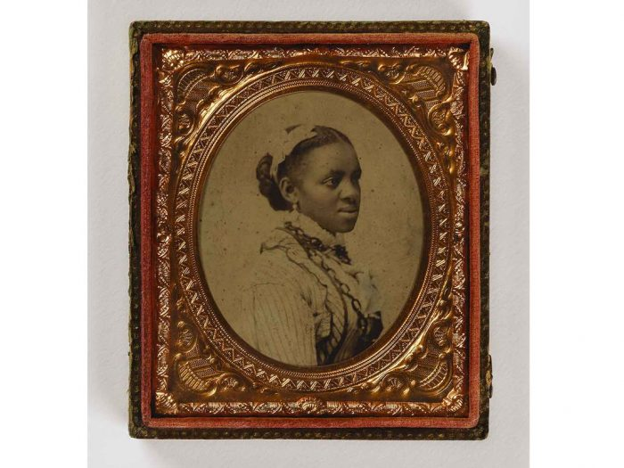 Young black woman with hair ribbon
